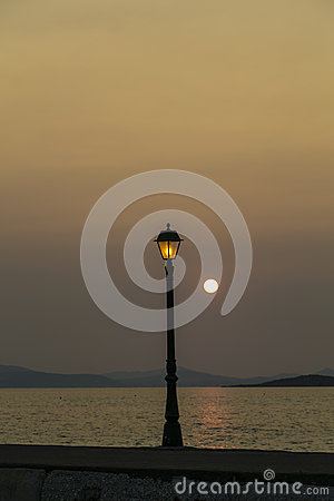 Free Sunset In A Habor With Old Street Light Stock Photo - 32846350