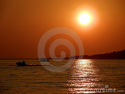 Sunset, jet ski and boat