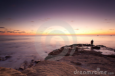 Sunset at La Jolla Cove with silhouette of couple
