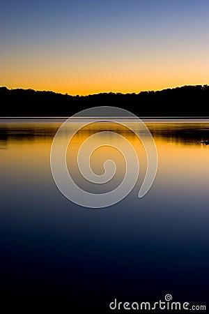 Sunset on lake reflection