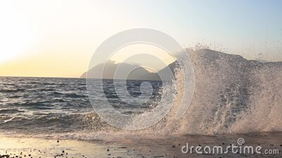 Surf at Sunset at the Concrete Pier. Slow Motion stock video footage