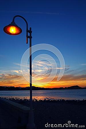 Sunset orange blue seascape light lamppost
