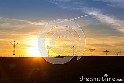 Sunset over airport runway.