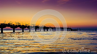 Sunset over baltic sea and pier