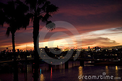 Sunset over canals and luxury homes.