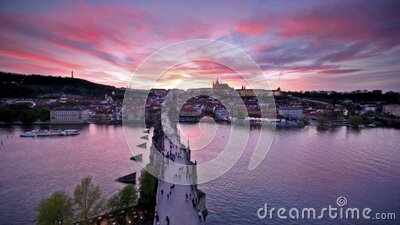 Sunset over Charles Bridge and Prague Castle, Czech Republic stock video footage