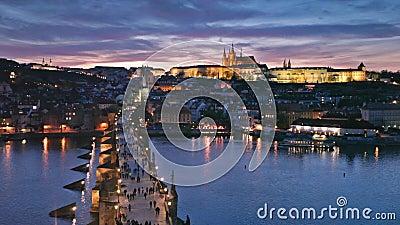 Sunset over Charles Bridge and Prague Castle, Czech Republic stock footage