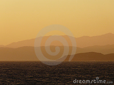 Sunset over coastal mountains
