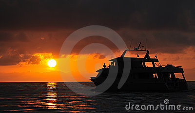 Sunset over dive boat