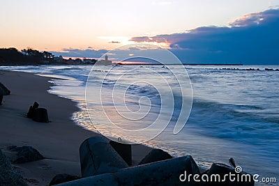 Sunset over a lighthouse. Dusk