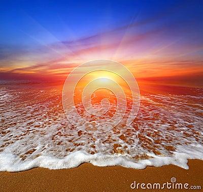 Sunset over ocean beach