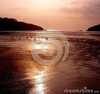 Sunset over Porth beach, England