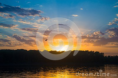 Sunset over river with forest