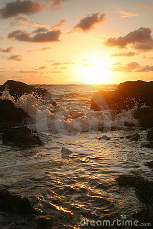 Sunset over rocky coast