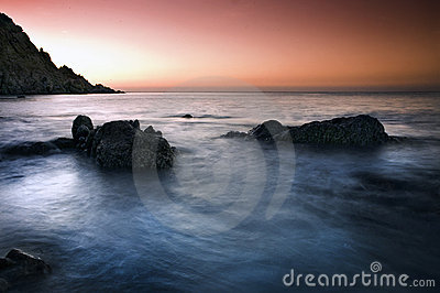 Sunset over rocky coast