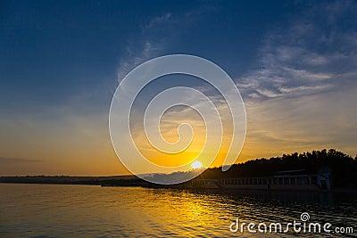 Sunset over the seashore summer evening landscape sea Stock Photo