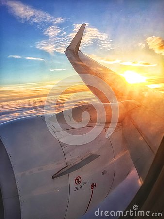 Free Sunset Over The Wing Of A Plane Royalty Free Stock Photography - 103454977