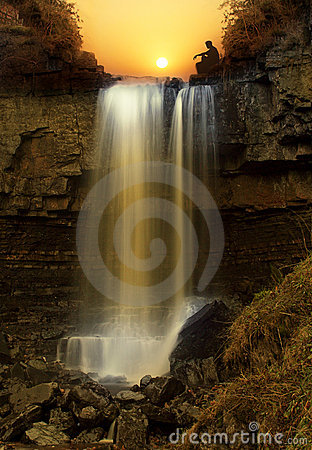 Free Sunset Over Waterfall Royalty Free Stock Image - 12765276