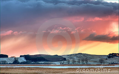 Sunset over wintry countryside
