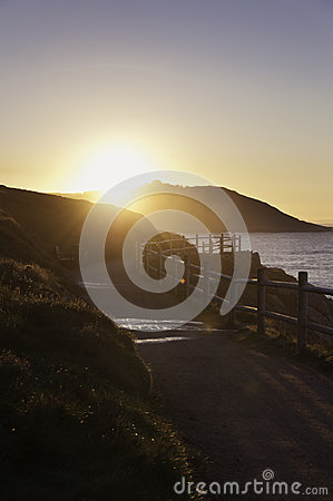 Sunset on a path near the sea