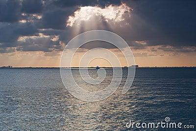 Sun Piercing Through Clouds