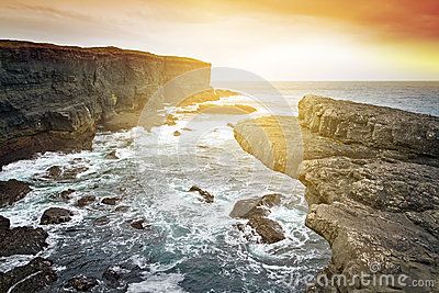 Sunset at raw cliff scenery