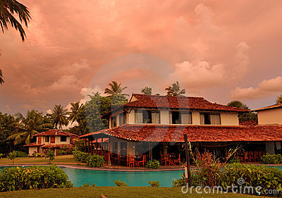 Sunset and restaurant at swimming pool
