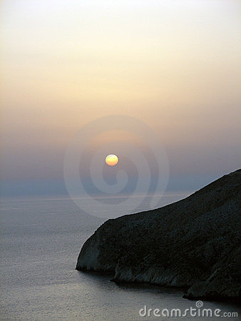 Sunset. Rock in Ionian sea