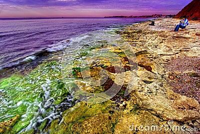 Sunset on rocky coastline