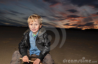 boy with Sunset on the sand
