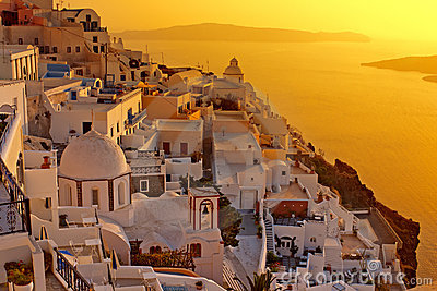 Sunset at Santorini island , Greek church