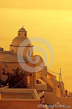 Sunset at Santorini island , Greek church
