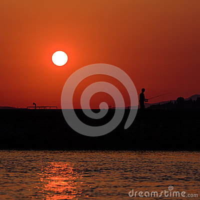 Sunset scene with fisherman