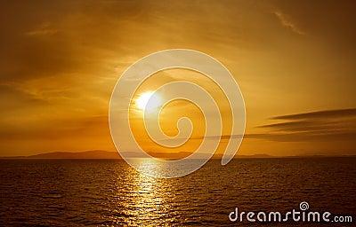 Sunset on sea. Bright sun on sky. beach landscape Stock Photo