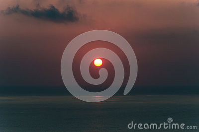 Sunset on sea. Bright sun on sky. beach landscape Stock Photo