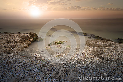 Sunset on sea. Bright sun on sky. Stock Photo