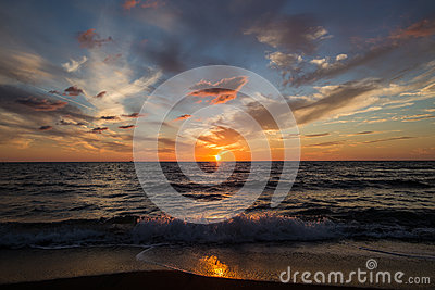 Sunset on sea. Bright sun on sky. Waves Stock Photo
