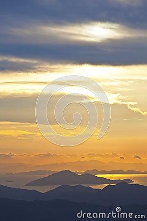 Sunset at sea and mountains in Hong Kong