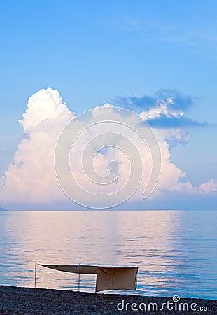 Sunset and shining sea surface