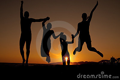 Sunset silhouette of family