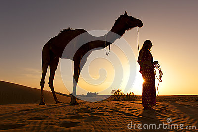 Sunset Silhouette of a woman and her camel.