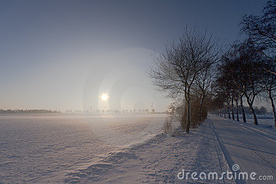 Sunset in snow and mist