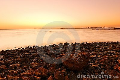 Sunset, stones and shoreline