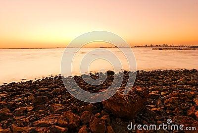 Sunset, stones and shoreline