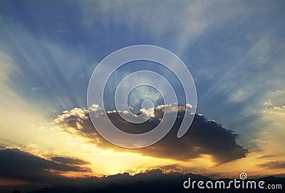 Sunset - The sun across clouds