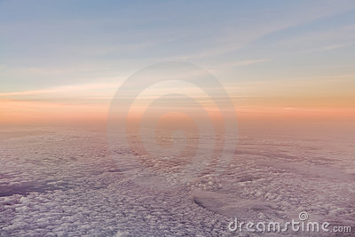 Sunset or sunrise over clouds