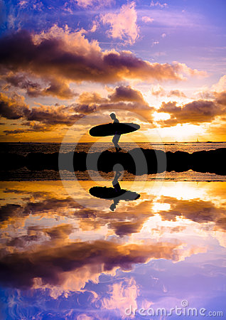 Sunset surfer silhouette reflection