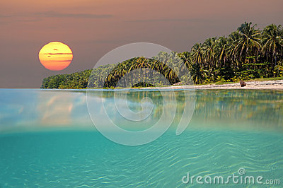 Sunset on tropical beach island