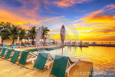 Sunset at tropical swimming pool