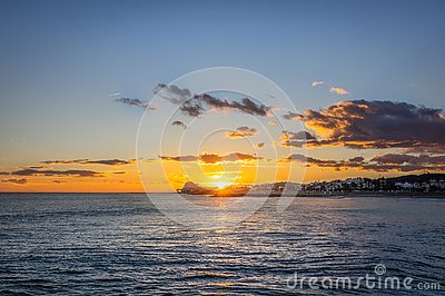 Sunset on vacation in the mediterranean. Golden hour by the sea. Sitges, Spain Stock Photo